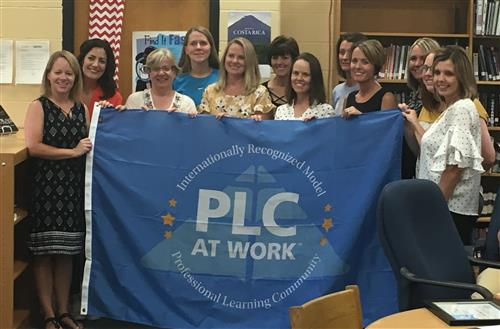 Picture of teachers receiving a PLC award